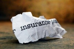 Crumpled Insurance Document   Widows Pay More for Auto Insurance