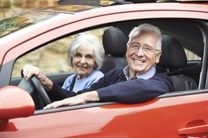 Portrait Of Smiling Senior Couple Out For Drive In Car | Falls Increase Car Accident Risk for Senior Drivers