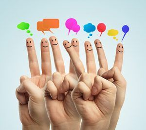 Happy group of finger smileys communicate with each other   social media can ruin your personal injury claim