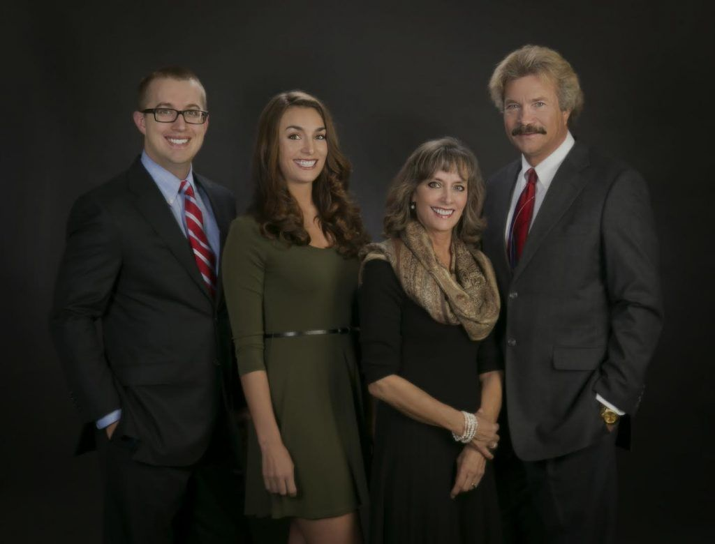 The staff of the family-run personal injury law firm Paysinger Law, P.C. in Lakewood, CO