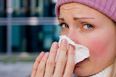 young female having a cold | BEWARE of Driving While Sick