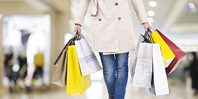 woman with colorful shopping bags walking in modern mall | Slip and Fall Accidents in Department Stores
