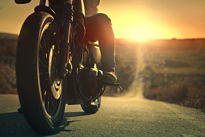 On a roaring motorcycle at sunset   7 Troublesome Motorcycle Myths