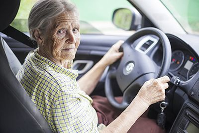 Senior woman driving a car looking pensive | Drugged Driving and the Elderly
