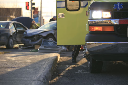 emergency vehicle at the scene of a car accident in a city | Most Common Injury Suffered in a Car Accident