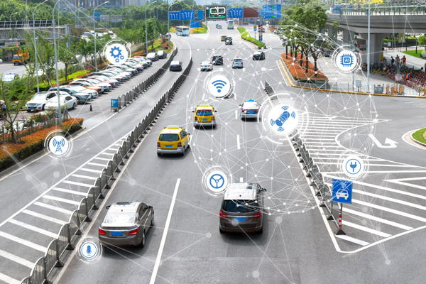 an abstract representation of cars on a 'smart road' | Will Smart Roads Decrease Accidents in Colorado?