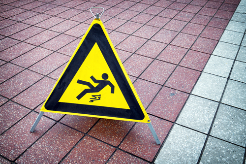 caution sign on tile floor | Common Places for Slip and Fall Accidents