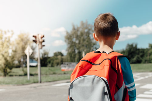 boy in backpack about to cross street | Colorado Drivers Among Nation's Worst in School Zones