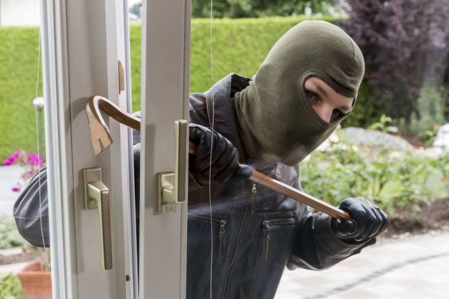 a burgler trying to enter a house | how dangerous is Arvada