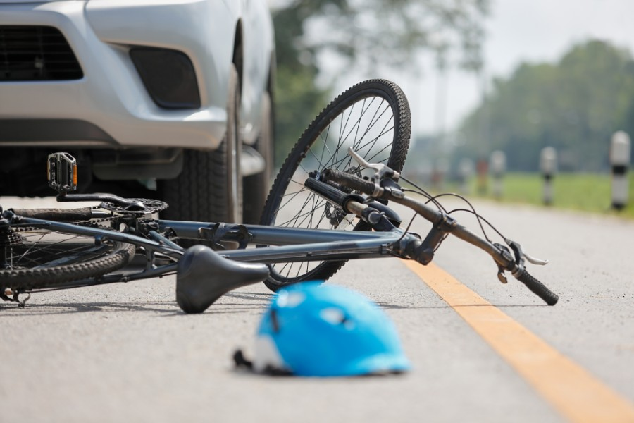 car run down a bicycle with the helmet on the ground | Fatal Bicycle Accidents