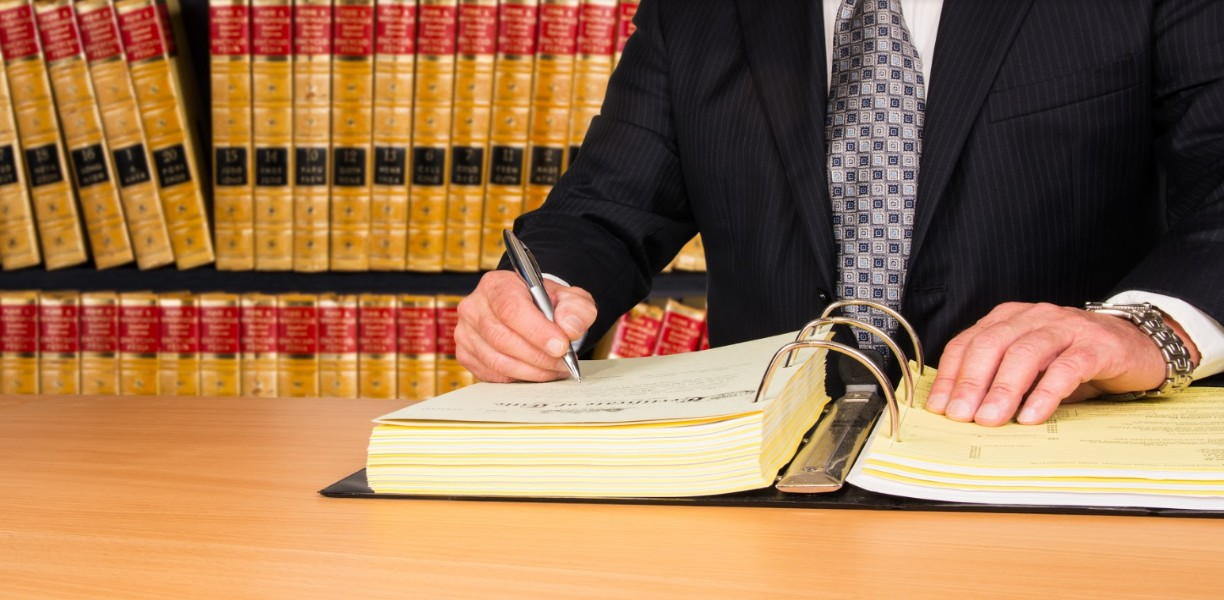 lawyer writing on a book | denver negligent security lawyers
