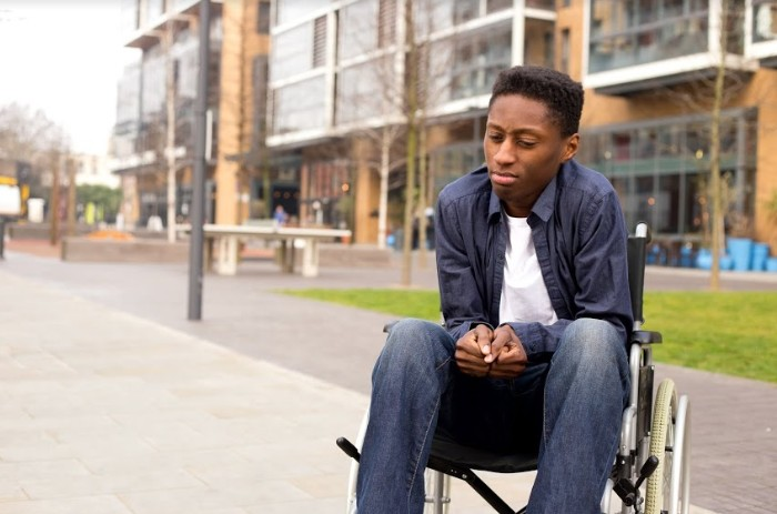 black man on a wheel chair | types of damages in a personal injury lawsuit