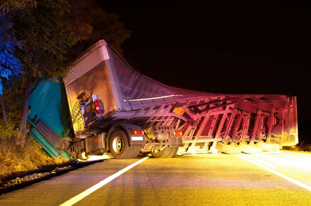 commercial truck tipped over during accident | fatal commercial trucking accident on i-70