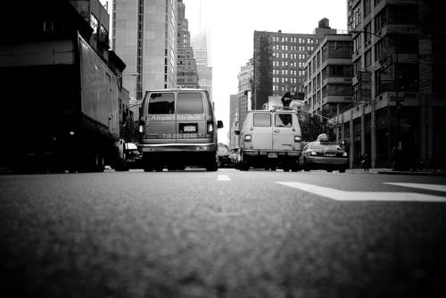 black and white photo of a busy street